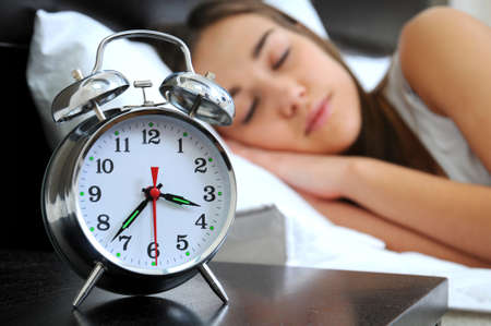 Clock with sleep at night  Woman can not sleep  photo