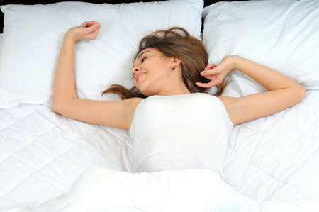 sleep well: Young beautiful, woman waking up fully rested