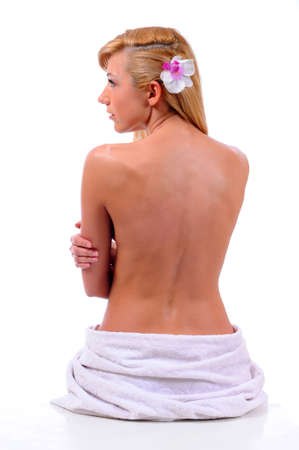 Beautiful back of a young woman after shower isolated on white background photo