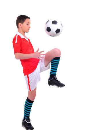 balls kids: boy playing with football against white background