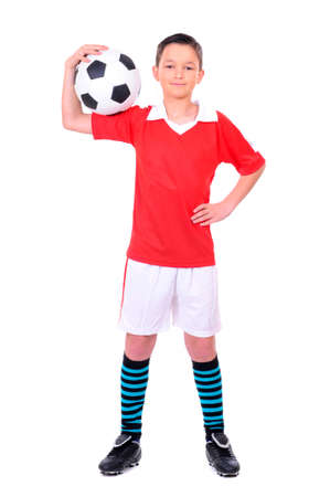 preteen boys: boy playing with football against white background