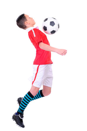 boy playing with football against white background photo