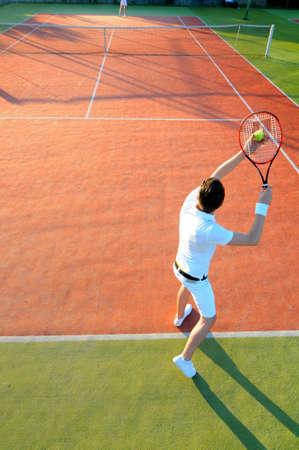 athletic gear: Man Playing Tennis