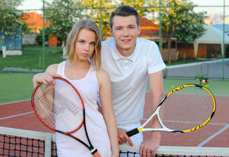 doubles: Couple playing doubles at the tennis court