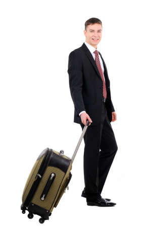 A businessman traveler waiting seated on to suitcase isolated on white background photo