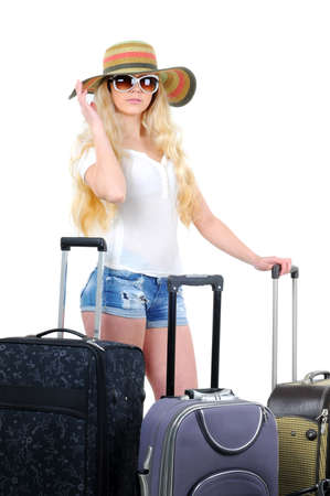 portrait of young female standing with suitcase going on holidays isolated on white background photo