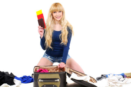 young woman seeking travel documents in a suitcase isolated on white photo