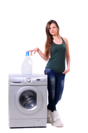 household tasks: A pretty young woman doing laundry