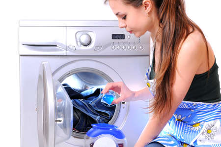soiled: A pretty young woman doing laundry