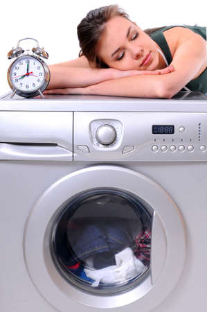 woman sleeping on a washing machine photo