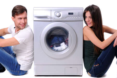 beautiful young couple with a washing machine photo