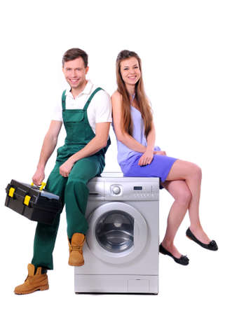 appliance: repairman and young girl sitting on the washing machine