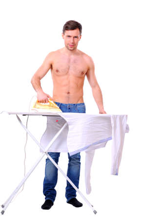 man ironing on a ironing board his shirt isolated on white background photo