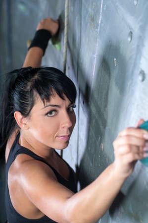 courageous: Women climbing on a wall in an climbing center