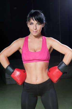 Portrait of a beautiful female boxer photo