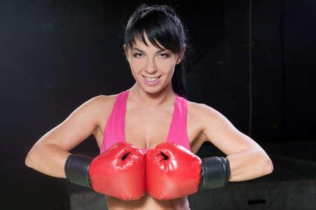 Portrait of a beautiful female boxer photo