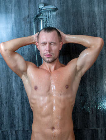 man shower: Close-up of a young man taking a shower Stock Photo