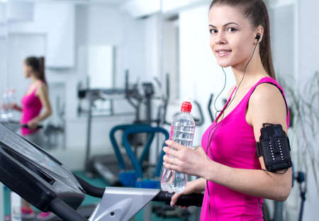 treadmill: Fitness Woman. Woman runs on a treadmill, exercise in the sport club
