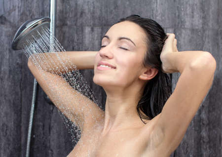 woman in shower: sexy and happy young beautiful woman taking a shower Stock Photo