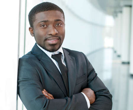 african business: Portrait of a successful African American business man at the office building