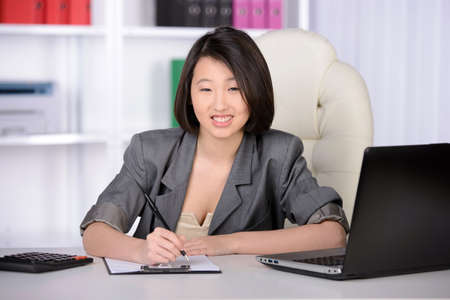 Business woman Asia, working in the office photo