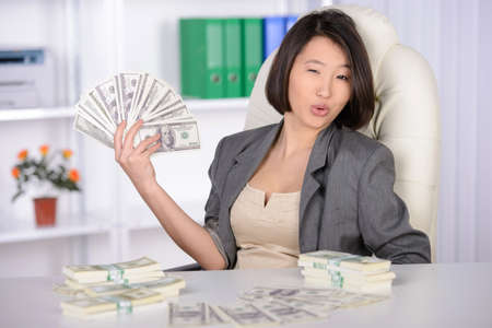 Business woman Asia, working in the office. Joy much money photo