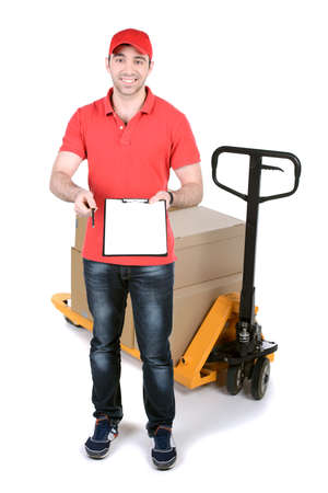 Happy smiling delivery man carrying boxes isolated on white background photo