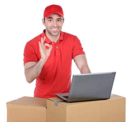 Happy smiling delivery man carrying boxes isolated on white background Stock Photo