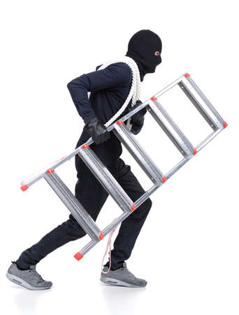 Male offender from Balaklava in the head with a rope and ladder  Isolated on white background Stock Photo