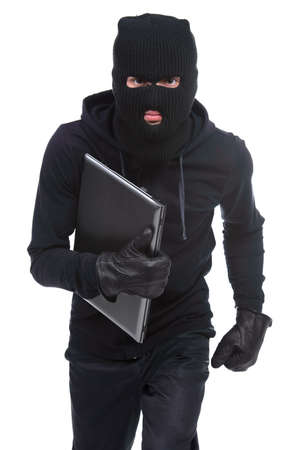 Thief stealing a laptop computer. Isolated on white background photo