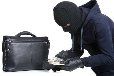 Portrait of running male burglar with a handbag. Isolated on white background Stock Photo - 28277600