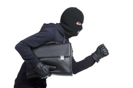 Portrait of running male burglar with a handbag. Isolated on white background Stock Photo - 28277610