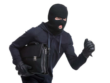 Portrait of running male burglar with a handbag. Isolated on white background Stock Photo - 28277607