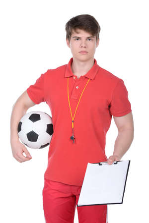 Football coach. Football coach with the ball and whistle isolated on white background photo