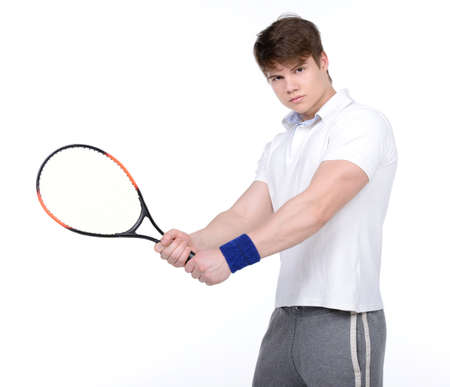 Sportive man playing tennis, isolated on white photo