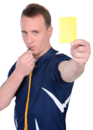 Soccer judge whistling and showing yellow card. Isolated on white photo