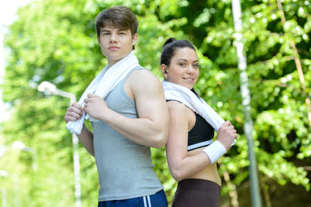 Sport connecting people. Side view of beautiful young couple in sports clothing after exercise photo