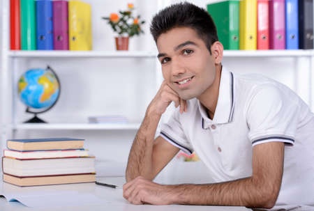 Portrait of a young student of India against the backdrop of the class room photo