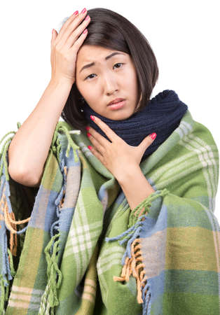 Pretty young asian woman is sick and has a headache. photo
