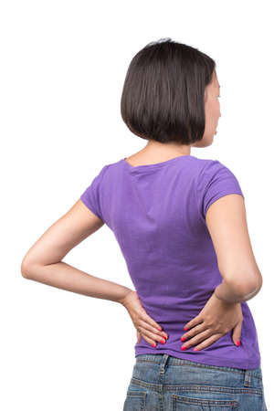 Pretty asian young woman has back pain isolated on white background. photo