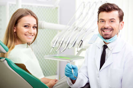 Dentist and female patient. Dental health care clinic. photo