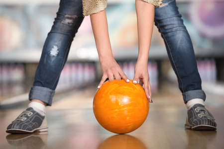 Woman in bowling alley. A woman is having fun while playing bowling. Stock fotó