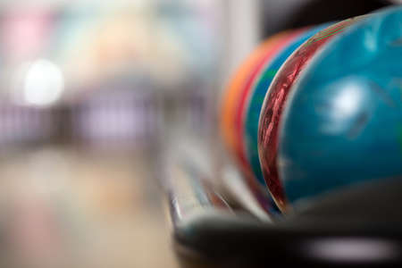 shiny floor: Close-up a group of colored bowling balls in the club. Stock Photo