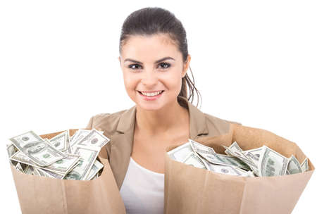 pretty girl: Young smiling woman with paper bags full of money, isolated on white background.