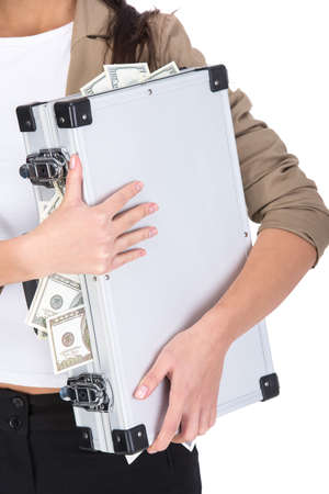 Close-up young woman is holding a suitcase full of money, isolated on white background. photo