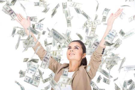 dinero volando: Mujer de negocios y dinero billetes joven que vuela en el aire en el fondo blanco.