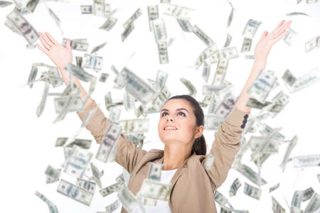 throw paper: Young business woman and money banknotes flying in air on the white background.