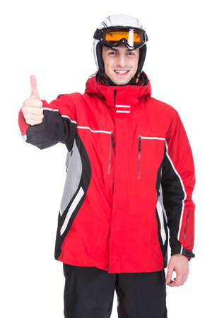 Portrait of young happy man in a ski suit, isolated on white background. photo