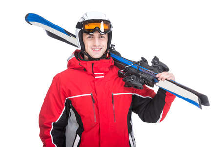 Young man is posing with skis in studio, isolated on white background. photo