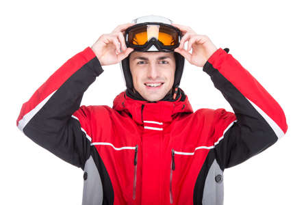 Portrait of young man in a ski suit, isolated on white background. photo